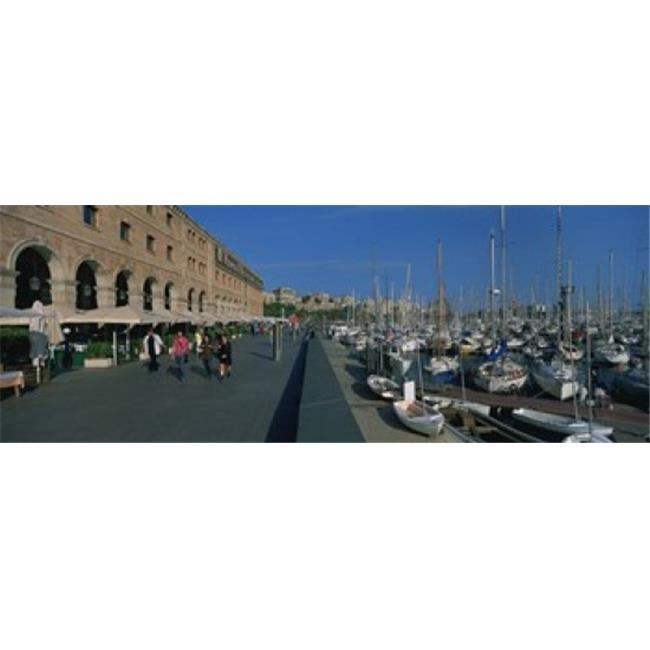 Panoramic Images PPI94936L Pedestrian walkway along a harbor  Barcelona  Catalonia  Spain Poster Print by Panoramic Images - 36 x 12