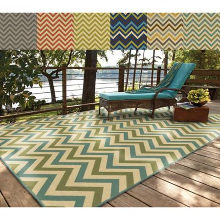 Style Haven Rio Mar Chevron Stripe Indoor/ Outdoor Area Rug This dramatic chevron pattern area rug will help your outdoor spaces feel more like home with its wide range of cool and bright colors. This durable polypropylene rug will endure the elements and continue to look great for many years.Machine wovenDurable with easy care and cleaningPrimary materials: 100 percent polypropyleneLatex: NoPile height: .16 inchesStyle: Indoor/OutdoorPrimary color: MultiSecondary colors:  Grey, Orange, Lime, Cobalt-Multi, Gray-Multi, Spa GreenPattern:  GeometricTip: We recommend the use of a  non-skid pad to keep the rug in place on smooth surfaces.All rug sizes are approximate. Due to the difference of monitor colors, some rug colors may vary slightly. Overstock.com tries to represent all rug colors accurately. Please refer to the text above for a description of the colors shown in the photo.Tip: We recommend the use of a  non-skid pad to keep the rug in place on smooth surfaces.All rug sizes are approximate. Due to the difference of monitor colors, some rug colors may vary slightly. Overstock.com tries to represent all rug colors accurately. Please refer to the text above for a description of the colors shown in the photo.Tip: We recommend the use of a  non-skid pad to keep the rug in place on smooth surfaces.All rug sizes are approximate. Due to the difference of monitor colors, some rug colors may vary slightly. Overstock.com tries to represent all rug colors accurately. Please refer to the text above for a description of the colors shown in the photo.