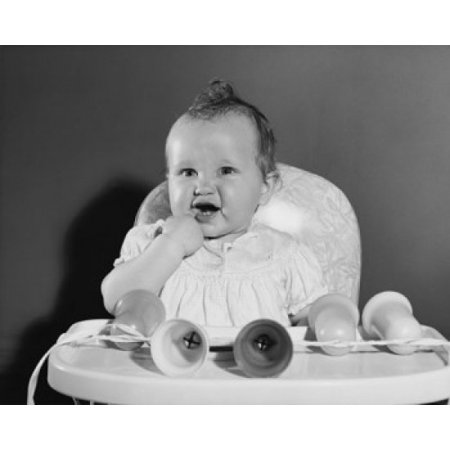 Baby girl sitting in a high chair with her finger in her mouth Canvas Art - (18 x 24)