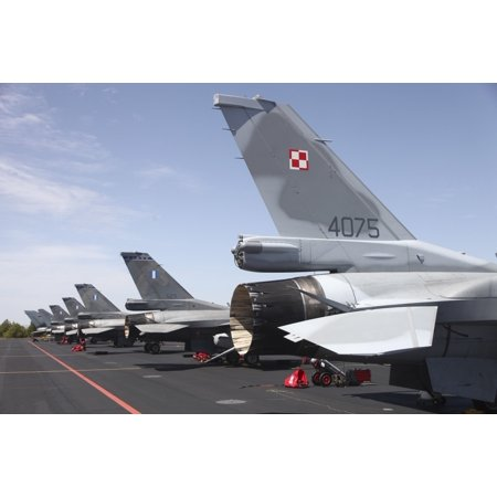 A row of F-16 fighter jets from the Polish and Greek Air Forces during the NATO Tactical leadership program at Albacete Air Base Spain Poster Print