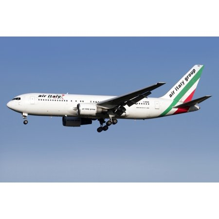 A Boeing 767 of Air Italy in flight over Italy Canvas Art - Luca NicolottiStocktrek Images (35 x 23)