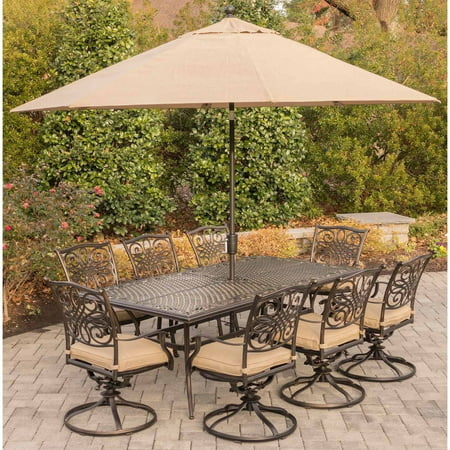 Hanover Outdoor Traditions 9-Piece Dining Set with 42u0022 x 84u0022 Cast-Top Table, 8 Swivel Rockers and Umbrella with Stand, Natural Oat