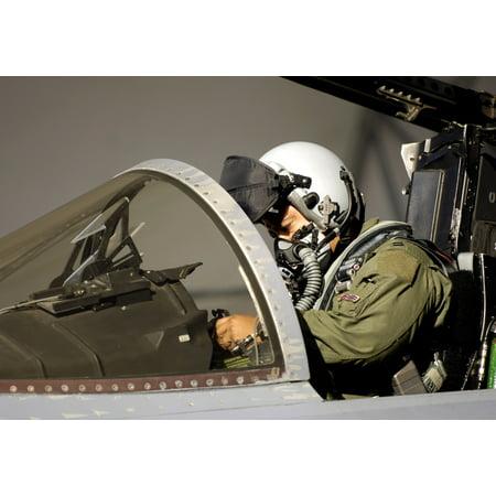 A pilot prepares his F-15A Eagle Stretched Canvas - Stocktrek Images (33 x 23)