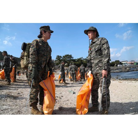 US and South Korea Marines and Sailors clean a local beach in Pohang Poster Print by Stocktrek