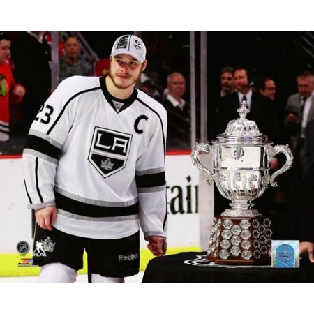 Stanley Cup Official Game - Dustin Brown with the Campbell Bowl after defeating the Chicago Blackhawks 5 to 4 in overtime of Game Seven to win the Western Conference Finals of the 2014 Stanley Cup Playoffs at United Center on Ju