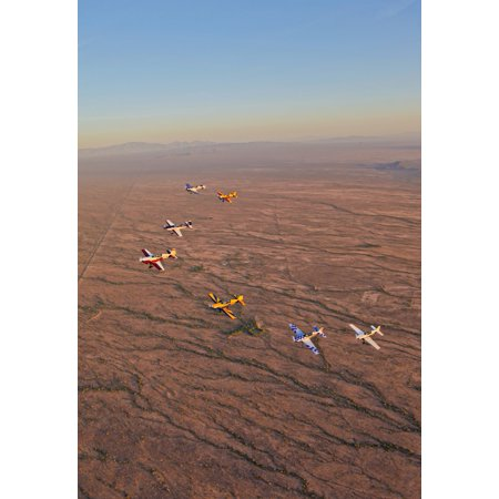 Extra 300 aerobatic aircraft fly in formation over Mesa Arizona Stretched Canvas - Scott GermainStocktrek Images (12 x