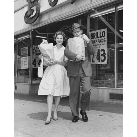 Mid adult couple carrying shopping bags in front of a store Canvas Art -  (18 x 24)](Adults Shopping)