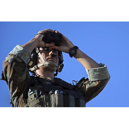US Special Operations soldier looks through a rangefinder Poster Print ()