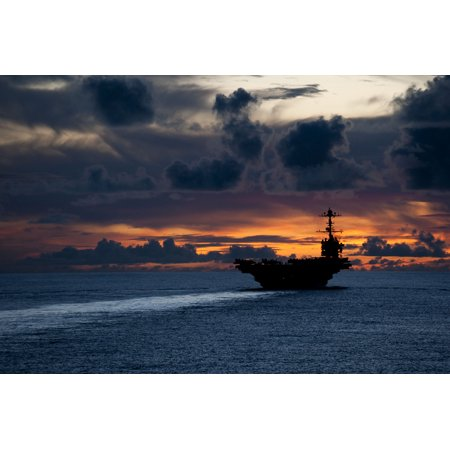 LAMINATED POSTER The aircraft carrier USS George Washington (CVN 73) is underway near Guam at sunset. George Washing Poster Print 24 x 36