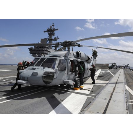 Crewmen prepare an MH-60S Sea Hawk helicopter aboard USS George HW Bush Canvas Art - Stocktrek Images (34 x 24)