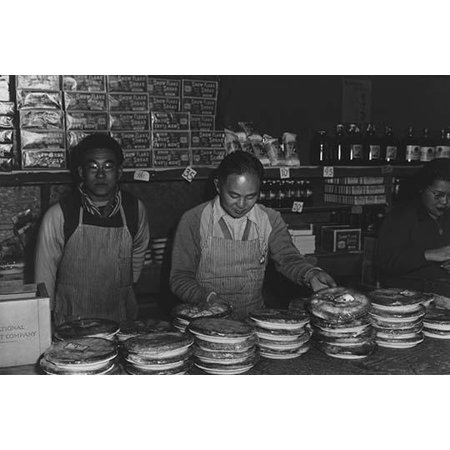Two men and a woman standing behind store counter with display of pies  Ansel Easton Adams was an American photographer best known for his black-and-white photographs of the American West  During