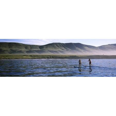 Tourists paddleboarding in the pacific ocean Santa Cruz Island Santa Barbara County California USA Canvas Art - Panoramic Images (18 x 6)