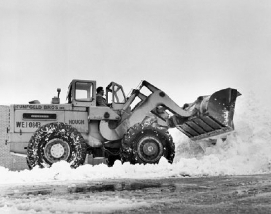Snowplow removing snow from a road Poster Print by Superstock