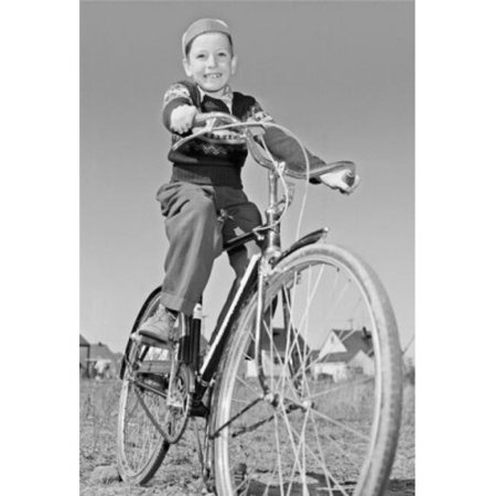 Posterazzi SAL2558817B Low Angle View of a Boy Riding a Bicycle Poster Print - 18 x 24