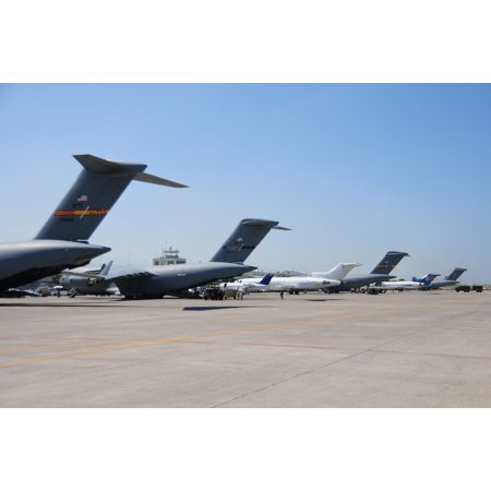 LAMINATED POSTER Military Cargo planes line up the runway at the airport in Port-au-Prince, Haiti. These cargo planes Poster Print 24 x 36