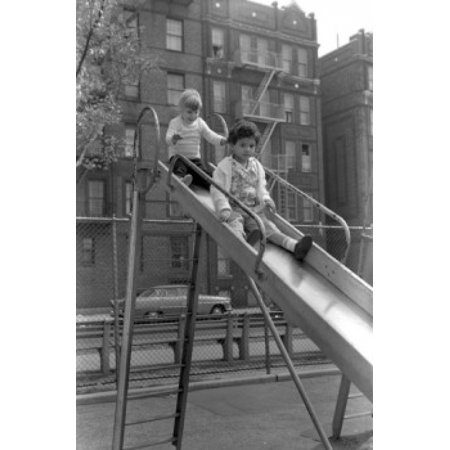 New York Apartment Buildings (USA New York City New York Children on slide in front of apartment building Canvas Art -  (18 x 24) )