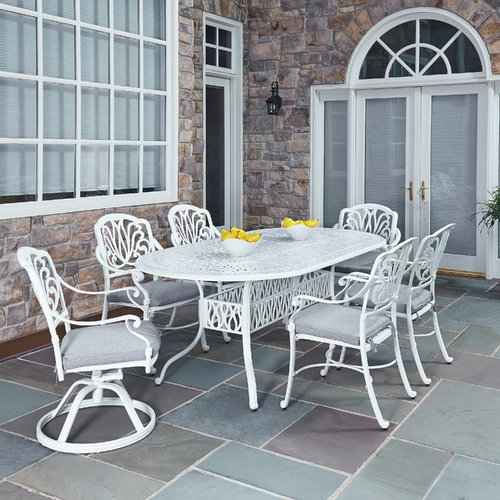 Home Styles Floral Blossom White 7pc Outdoor Dining Set with Oval Dining Table, 2 Swivel Chairs and 4 Arm Chairs