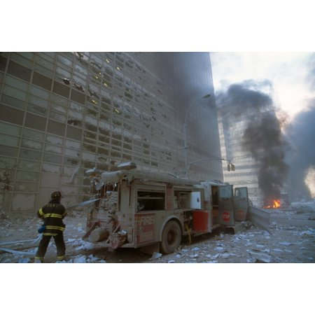 Nyc Fireman Pulling Water Hose From Fire Truck After The 9-11 Terrorist Attack On World Trade Center View Is Toward West Broadway And A Burning Car