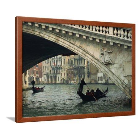 Gondola under the Rialto Bridge on the Grand Canal in Venice, Veneto, Italy Framed Print Wall Art By Rainford