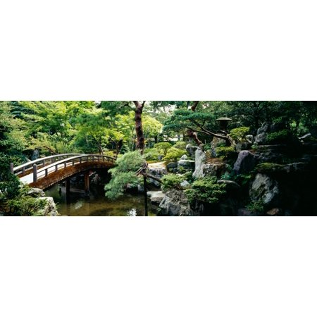 Footbridge across a pond Kyoto Imperial Palace Gardens Kyoto Prefecture Japan Stretched Canvas - Panoramic Images (27 x