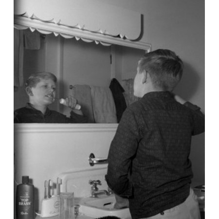 Boy brushing teeth with electric toothbrush Canvas Art - (18 x 24)