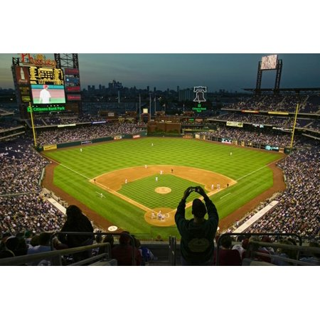 A fan with a digital camera taking a panoramic image of Citizens Bank Park, Philadelphia, PA, on... Print Wall