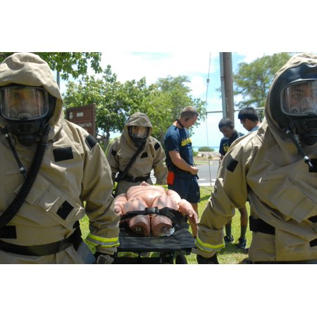 Laminated Poster Members Of The Hawaii Air National Guards Fatality  Search  And Recovery Team Practice Fatality Tra Poster Print 24 X 36