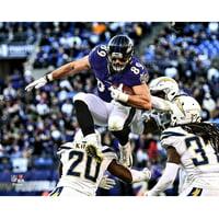 Mark Andrews Baltimore Ravens Unsigned Hurdling Defender Photograph