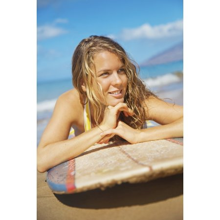 A Young Woman Lays On A Surfboard On The Sand Maui Hawaii United States Of America Stretched Canvas - Brandon Tabiolo  Design Pics (12 x 19)