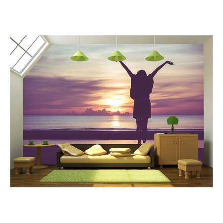 wall26 Woman Spreading Hands with Joy and Inspiration at Sunrise Remov