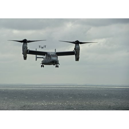 Laminated Poster An Mv 22B Osprey Transport Aircraft Assigned To The Blue Knights Of Marine Medium Tiltrotor Squadron Poster Print 24 X 36
