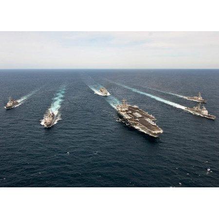 The Enterprise Carrier Strike Group transits the Atlantic Ocean Poster Print by Stocktrek Images