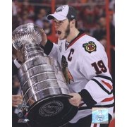 Jonathan Toews with the 2009-10 Stanley Cup by Photofile