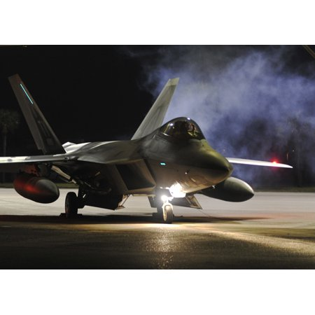 LAMINATED POSTER A 95th Fighter Squadron F-22 Raptor prepares to taxi down the Tyndall Air Force Base, Fla., flightli Poster Print 24 x 36
