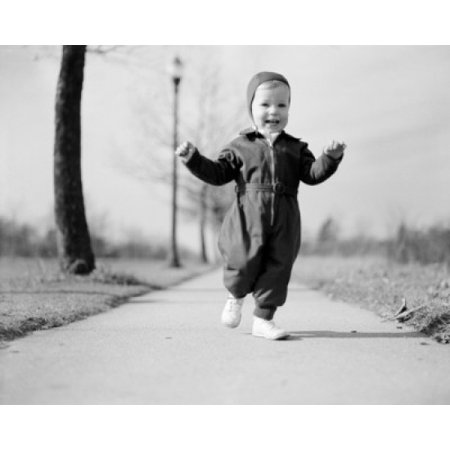 Portrait of exhilarated baby girl on footpath Canvas Art - (24 x 36)