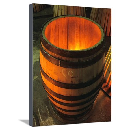 Toasting a New Oak Wine Barrel at the Demptos Cooperage, Napa Valley, California, USA Stretched Canvas Print Wall Art By John Alves