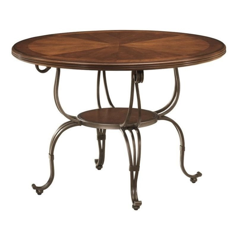 Ashley Plentywood Round Dining Table in Brown by Ashley Furniture