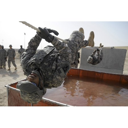 April 25 2009 - Army Specialist uses a 15 foot rope to cross a water obstacle with his teammates following behind during a Defender Challenge course at an air base in Southwest Asia Poster Print 15 Mm Southwest Design