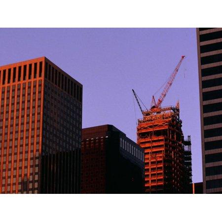 Crane Atop Skyscraper under Construction in City Print Wall