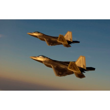 F-22A Raptors fly over Langley Air Force Base Virginia Poster Print by Stocktrek -