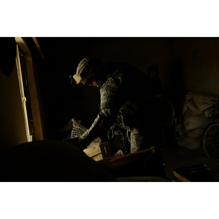 LAMINATED POSTER U.S. Army Sgt. Gregory Turk searches a house for items of interest during an Iraqi police led missio Poster Print 24 x 36 (Steampunk Items For Sale)