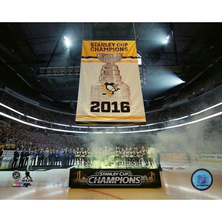 The Pittsburgh Penguins raise the 2016 Stanley Cup Champions banner at PPG Paints Arena October 13 2016 Photo Print