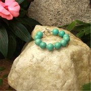 Betty Rocks BBRSTQ101160007T1 7 in. 16mm Round Stabilized Turquoise Bracelet