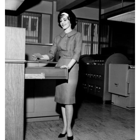 Insulated Holding Cabinet - Businesswoman holding a card beside a filing cabinet Stretched Canvas -  (24 x 36)