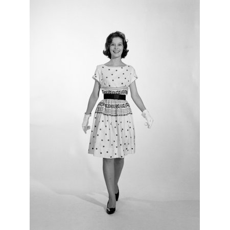 Polka Dot Heels Shoes - 1960s-1950s Smiling Woman Walking To Looking At Camera Wearing Polka Dot Cotton Dress High Heel Shoes And White Gloves
