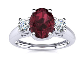 1 1 5 Carat Oval Shape Garnet and Two Diamond Ring In 14 Karat White Gold Size 6.5 by