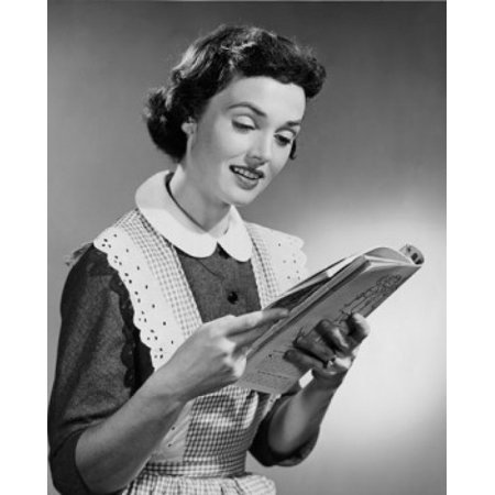 - Young woman reading magazine Poster Print