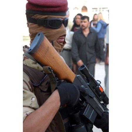 An armed Iraqi Army guard provides security Poster Print by Stocktrek Images