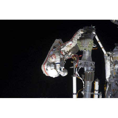 August 20 2012 - Russian cosmonaut uses a still camera during a session of extravehicular activity to continue outfitting the International Space Station Poster Print