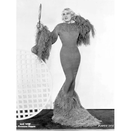 Mae West standing in Classic Long Gown Print Wall Art By Movie Star News